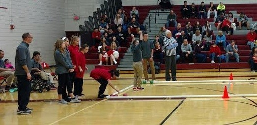 This photo shows students playing bocce in our HS gymnasium with approximately 75 adult sand students in the stands cheering them on.