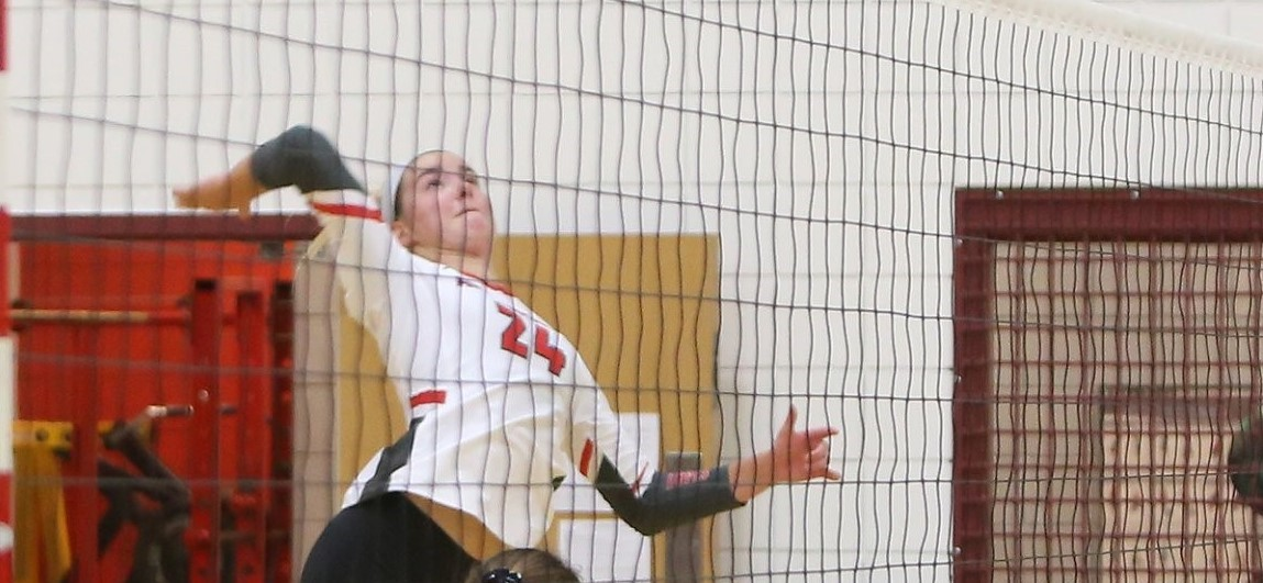 Photo of Makenna Gavin elevated and about to hit a kill during an avonworth girls volleyball game.