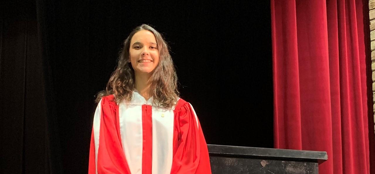Photo of student Abigail Adamiak in her PMEA choir robe.