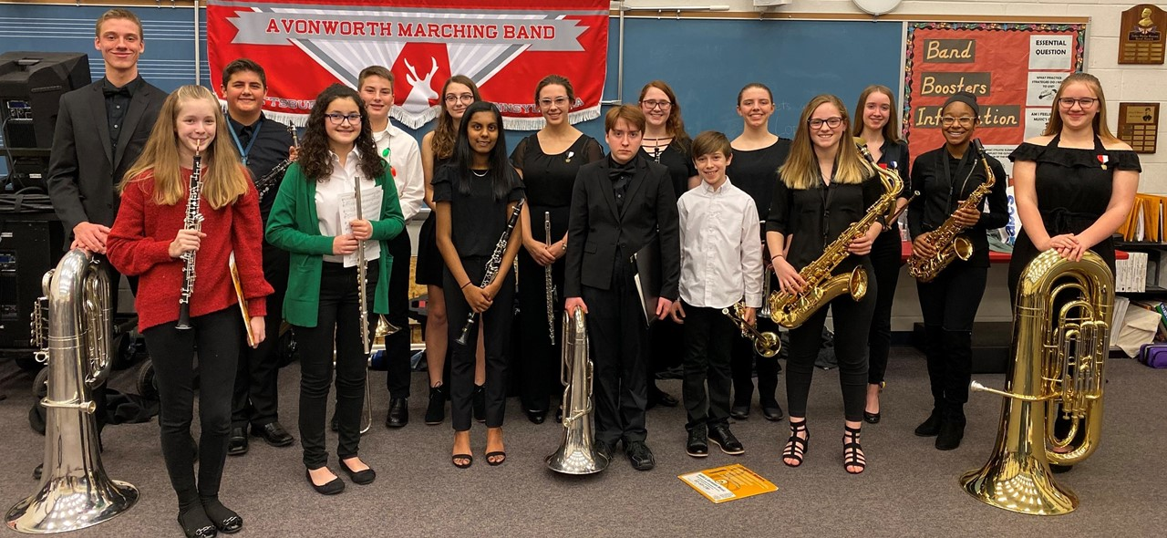 Photo of sixteen musicians from the avonworth band that were selected to the allegheny valley junior high and senior high honors bands.  Photo was taken in the band room at the high school.