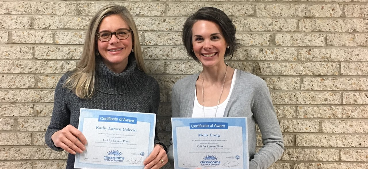 Photo of Mrs. Galecki and Mrs. Long holding certificates they were presented by classrooms without borders for their award winning lessons.