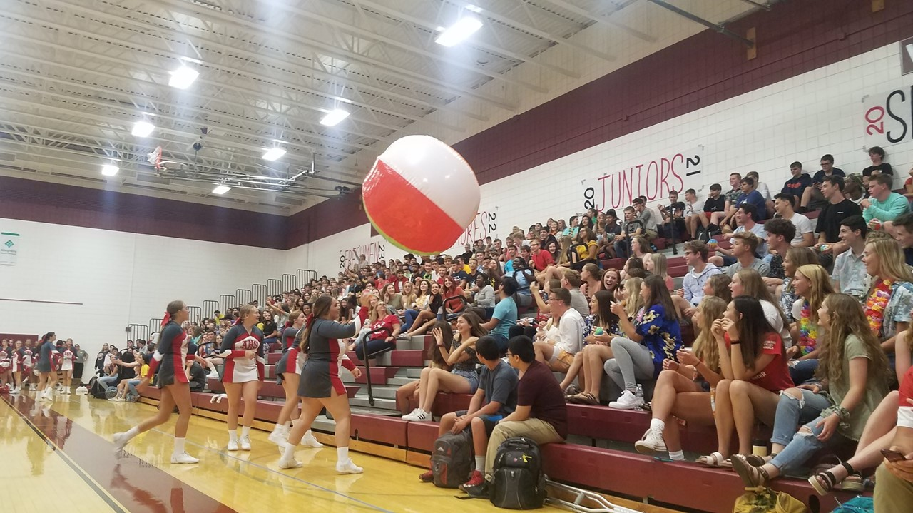 AHS Pep Rally on August 23rd.  Students seated in bleachers and cheerleaders on gym floor hitting a giant beach ball around.