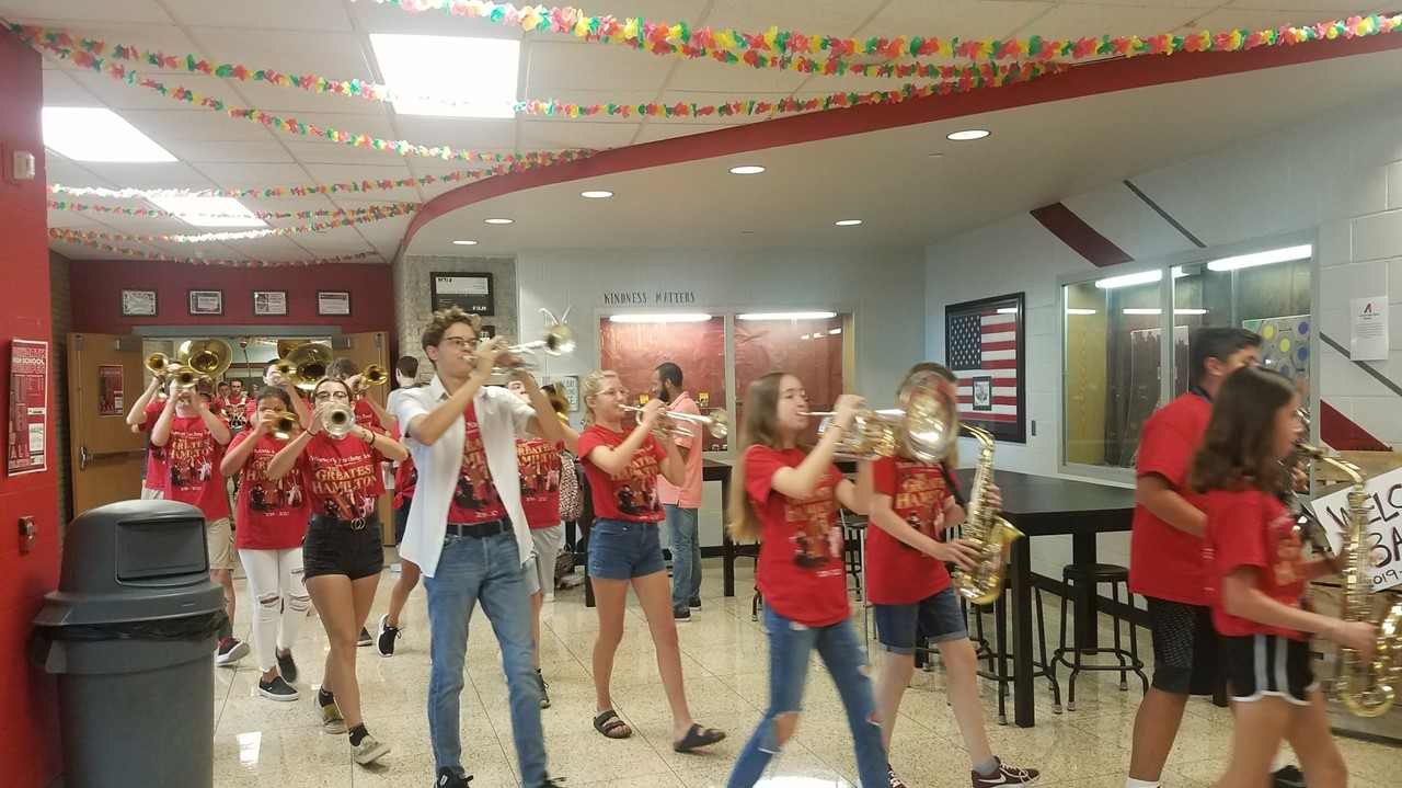 AHS Band playing instruments while walking through the HS hallways - August 23rd, 2019
