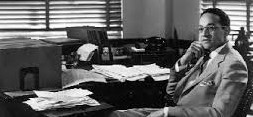 Photo of Raymond Pace Alexander:  First African American to graduate from the Wharton School.  Photo is of him sitting at his desk.